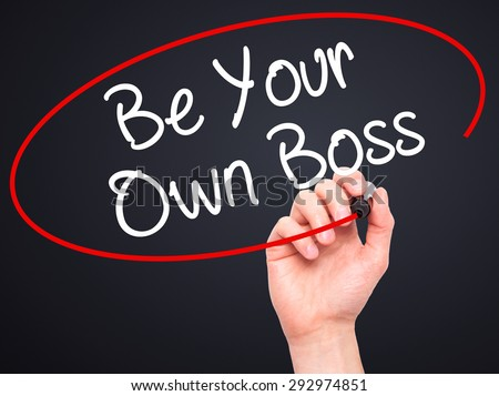 Man Hand writing Be Your Own Boss with black marker on visual screen. Isolated on black. Business, technology, internet concept. Stock Image