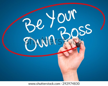 Man Hand writing Be Your Own Boss with black marker on visual screen. Isolated on blue. Business, technology, internet concept. Stock Image