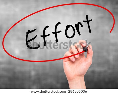 Man hand writing Effort on visual screen. Business,help, internet, technology concept. Isolated on grey. Stock Photo