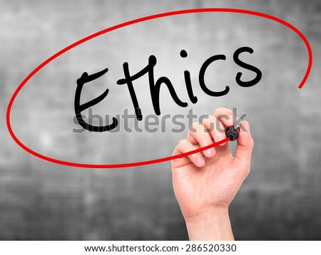 Man hand writing Ethics on visual screen. Business,help, internet, technology concept. Isolated on grey. Stock Photo
