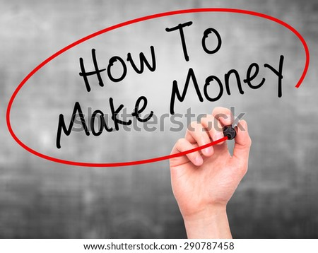 Man Hand writing How To Make Money with black marker on visual screen. Isolated on grey. Business, technology, internet concept. Stock Image