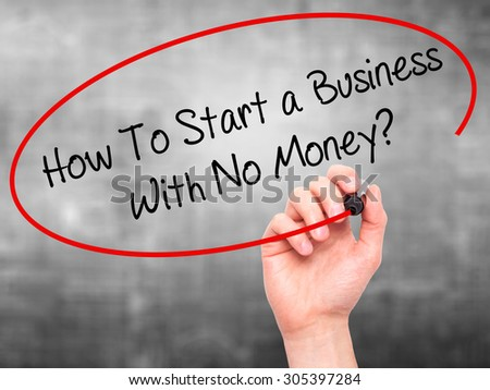 Man Hand writing How To Start a Business With No Money? with black marker on visual screen. Isolated on grey. Business, technology, internet concept. Stock Photo