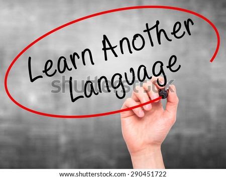 Man Hand writing Learn Another Language with black marker on visual screen. Isolated on grey. Learn, technology, internet concept. Stock Image