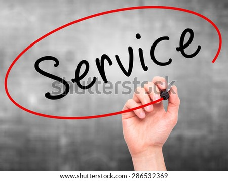Man hand writing Service on visual screen. Business,help, internet, technology concept. Isolated on grey. Stock Photo