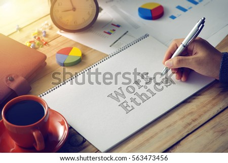Man hand writing word work ethics  #563473456