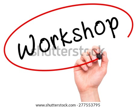 Man Hand writing Workshop with marker on transparent wipe board. Isolated on white. Business, internet, technology concept.  Stock Photo