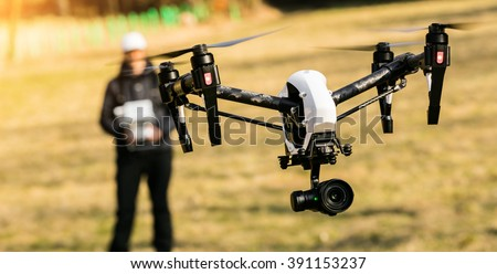 Man handling drone in nature