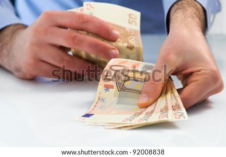 Man handling money.