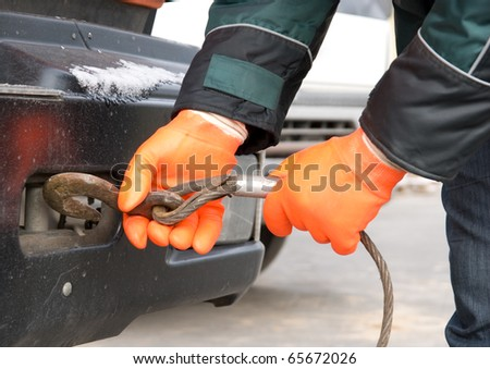 Man hands closeup with towing cable - stock photo