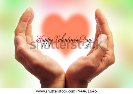 man hands forming a cup and the sentence happy valentines day with a heart in the background