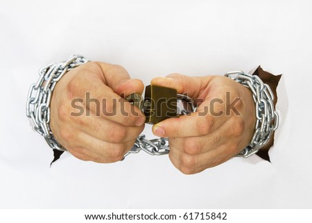 man hands handcuffed with chains holding the lock and the key