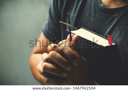 Man hands holding cross are praying for God's blessings.pray concept