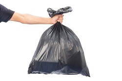 Man hands holding garbage bag isolated on white background.