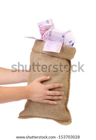 Man hands holding money bag full with euro bills