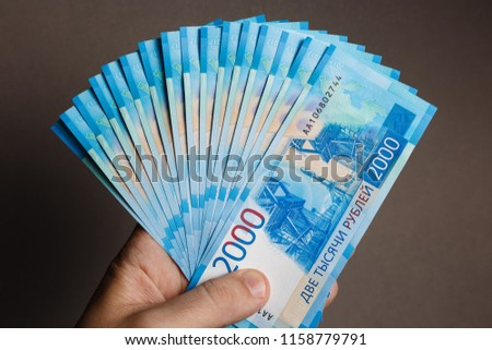 Man hands holding stack of money. Fan of money in the hands of man #1158779791