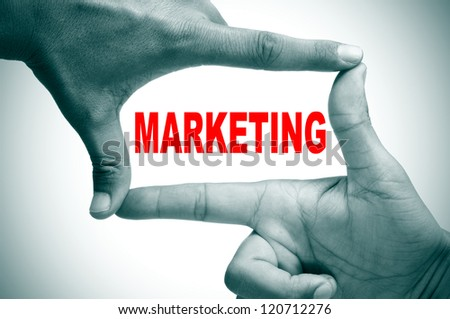 man hands making a frame with its fingers and the word marketing written inside