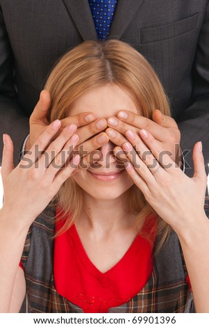 Man hands over young woman eyes close up