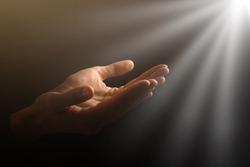 Man hands praying in dark background