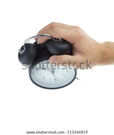 Man hands the old-fashioned alarm clock isolated on a white background