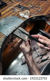 Stock Photo of a man hands working with tools in artisan workshop