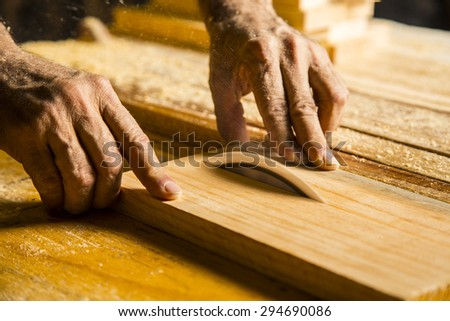 Man hands working in furniture wood industry