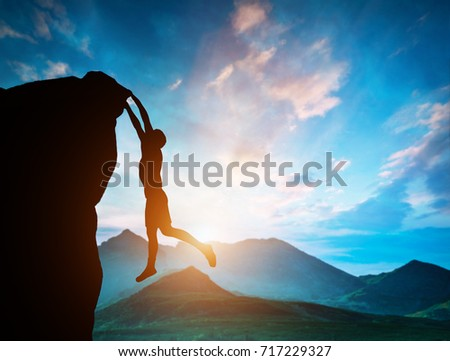 Man hanging on the edge of mountain at sunset. Danger, risky adventure, free climbing concepts. 3D illustration