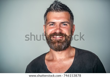 Man happy smile on bearded face with stylish haircut on grey background. Stomatology, dental treatment concept. Barbershop, hairdresser or beauty salon