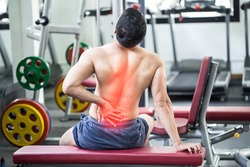 man have injury a back pain after workout in gym,Healthcare concept