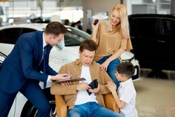 man have no money to buy specific car in dealership, helpful consultant offers cheapest options represented for sale