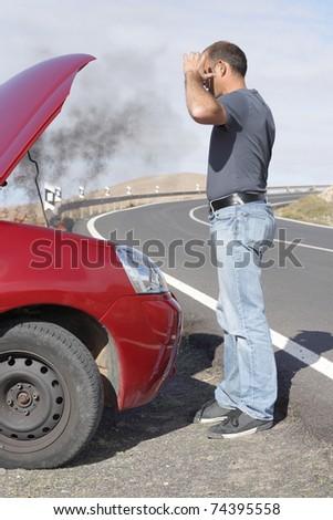man having a car breakdown
