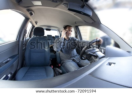 man having a phone call on cellphone while driving - stock photo