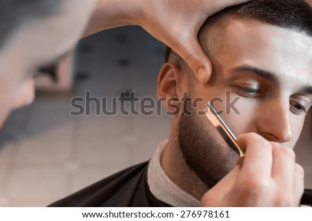 man having a shave at the...