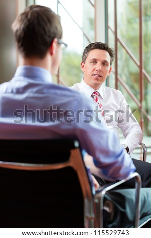 Man having an interview with manager employment job candidate hiring resume CEO work business - stock photo