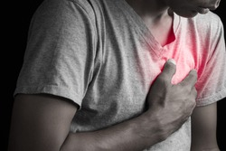 Man having chest pain, heart attack.