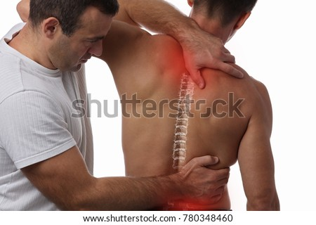 Man having chiropractic back adjustment. Osteopathy, Physiotherapy, sport injury rehabilitation concept