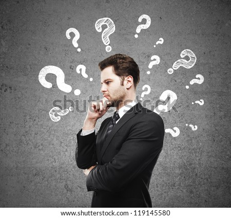 man having questions and concrete wall