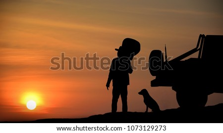 Man he is watching The sun is falling Beside the car and dog hold the guitar #1073129273