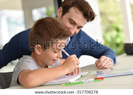 Man helping son with homework