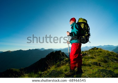 man hiking in mountain with backpack