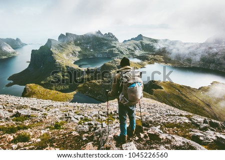 Man hiking in mountains enjoying Norway landscape Travel adventure healthy lifestyle concept active backpacking wanderlust summer vacations outdoor