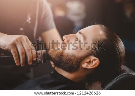 Man hipster having barber shave  barbershop.