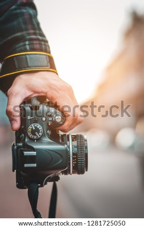 Man hipster, Professional photographer landscape with dslr camera in hands for ready to take pictures, Photographers takes snapshots for pleasure to remember events, vintage tone