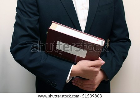 Man hold a textbook as a student.