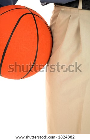 Man holding a basketball.