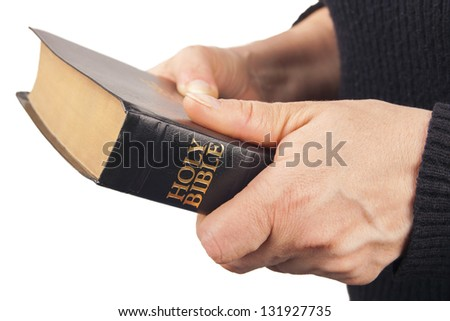 Man Holding a Bible isolated on white
