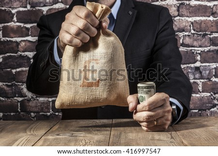 Man holding a big sack of money #416997547