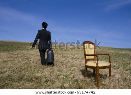 Man holding a big travelling bag going away alone
