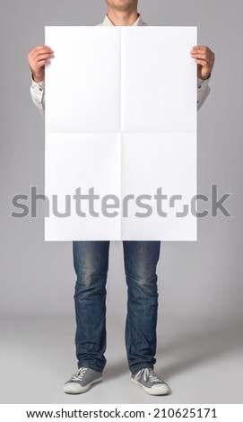 Man holding a blank poster #210625171