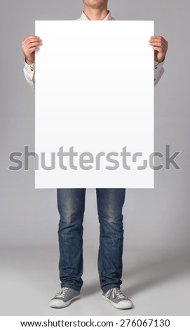 Man holding a blank poster #276067130