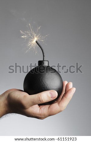 Man holding a bomb in his hand